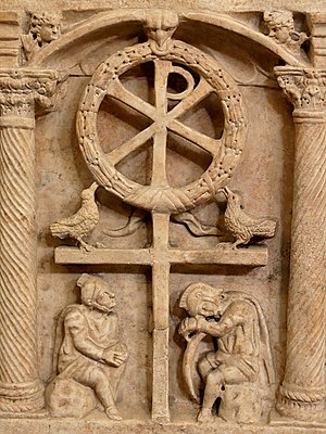 Resurrection of Jesus in Christian art - The Chi Rho with a wreath symbolizing the victory of the Resurrection, above Roman soldiers, c. 350
