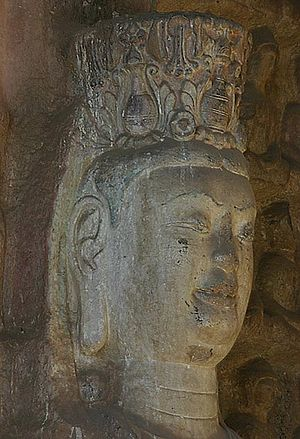 Tuoshan - Detail of the head of an attendant Boddhisattva figure.