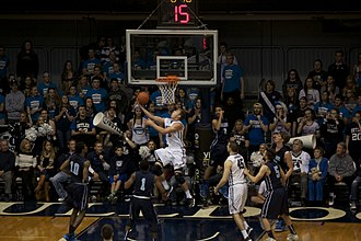 2014–15 Butler Bulldogs men's basketball team - Austin Etherington, completing a layup in a game vs. Maine, transferred from IU to Butler in the offseason.