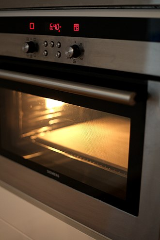 Baking stone - A large baking stone inside an oven