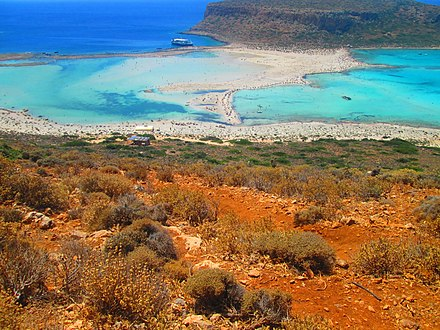 Balos coastal lagoon of northwestern Crete. The shallow lagoon is separated from the Mediterranean sea by narrow shoals connecting to a small, rocky mountain. BalosLagoonCreta.jpg