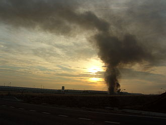 2006 Madrid–Barajas Airport bombing - Smoke billows from the parking building