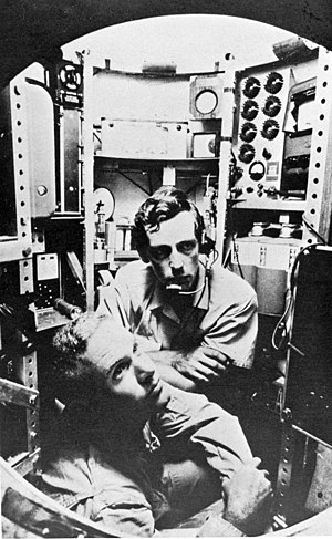 Challenger Deep - Lt. Don Walsh, USN (bottom) and Jacques Piccard (center) in the bathyscaphe Trieste.