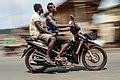 Bike rider with passenger.jpg