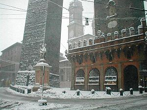 Towers of Bologna - The towers and the statue of Saint Petronius covered with snow.