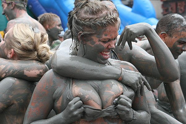 Mud wrestling, an erotic or sensual activity, not a formal sport.