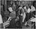 Both men and women man the machines which are turning out parts for America's bomber planes at Willow Run, Mich. - NARA - 195476.tif