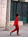 Boy walking - red sport cloths - christ st - Nishapur.JPG