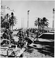 British tanks and crews line up on Tripoli's waterfront after capturing the city. - NARA - 196346.jpg