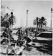 British tanks and crews line up on Tripoli's waterfront after capturing the city. - NARA - 196346