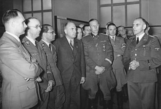 Operation Barbarossa - Heinrich Himmler, Rudolf Hess, and Reinhard Heydrich listening to Konrad Meyer at a Generalplan Ost exhibition, 20 March 1941