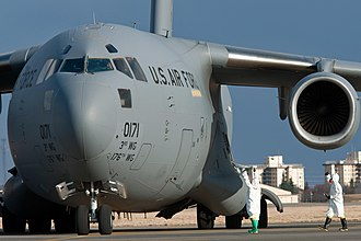 A USAF C-17 is checked for radiation at Yokota after a relief flight. C-17 Globemaster III Yokota.jpg
