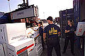 CBP Cargo Examination inspectors at boxes.jpg