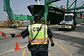 CBP officer directing a truck.jpg