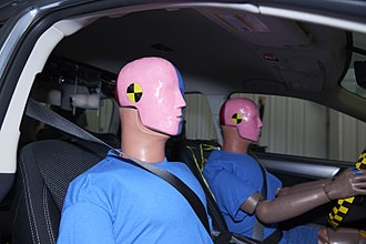Crash test dummy - Two male Hybrid III crash test dummies inside a Subaru Outback.