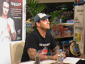 English: Is the wrestler CM Punk signing autog...