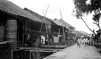 Bagansiapiapi - The chinese fishing village, with wooden road on poles of 1200 meters long and 3 meters wide, taken around 19th century