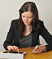 CSIRO ScienceImage 2102 A woman seated at a desk using mobile devices.jpg