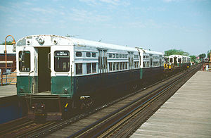 "Chicago ""L"" rolling stock - 6000-series work train cars at the California station on the O'Hare branch on May 19, 1985."