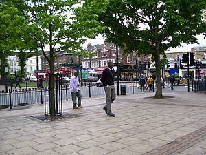Catford - The town centre, with the 'village green' including water pump just visible to the right
