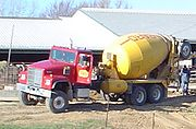 """A concrete transport truck, also referred to as a """"cement mixer"""", or a """"transit mixer""""."""