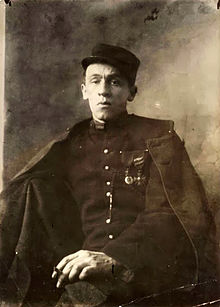 Cendrars posing in the uniform of the Légion étrangère in 1916, a few months after the amputation of his right arm