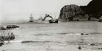 Knysna - The SS Agnar tows an unknown sailing ship into Knysna Harbour in 1910.