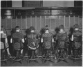Chesapeake and Potomac Telephone Company. View of row of operators. View of chairs showing type of chairs used by... - NARA - 522875.tif