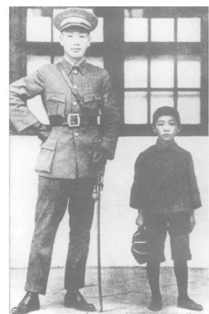 Chiang Wei-kuo age 8 with father