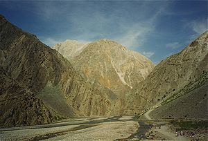 Vast mountains and people in the Chitral Valle...