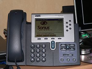A Cisco 7960 VoIP telephone displaying a Sonus...