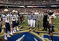 Coin toss at 2008 EagleBank Bowl 081220-N-7090S-110.jpg
