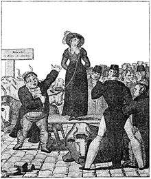 A woman stands on a raised platform, her eyes closed. A man stands below her, holding a halter which is connected to her waist. A group of men stand to the right, studying the woman. Livestock stand freely amongst the men, and one stands in a position behind the 'seller' which makes it appear as though he has horns growing from his head.
