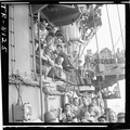 Crewmen laughing as they listen to pilots humorously describe encounter with Jap planes over bullhorn aboard the USS... - NARA - 520897.tif