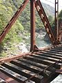 Cross the bridge on the abandoned railway hike in Takarazuka, Japan.jpg