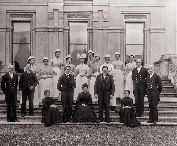 Group photo c. 1905 of the household staff of Curraghmore House, Portlaw, Co. Waterford. Via Wikimedia Commons.