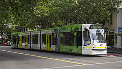 D2 5001 (Melbourne tram) in Elizabeth St on route 19 to North Coburg in PTV livery, December 2013.jpg