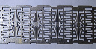 Dual in-line package - Dual in-line (DIP) integrated circuit metal tape base with contacts