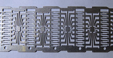 Dual in-line (DIP) integrated circuit metal tape base with contacts DIP zagotovka.jpg