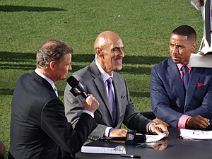 Tony Dungy - Dungy (center) along with colleagues Dan Patrick and Rodney Harrison at a NFL game in Denver in September, 2013.