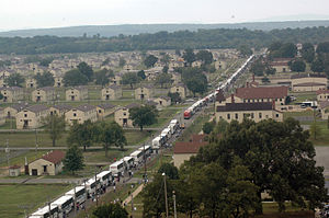 Fort Chaffee Maneuver Training Center - Busses loaded with Hurricane Katrina refugees arrive at Fort Chaffee
