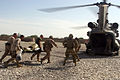 Defense.gov News Photo 110425-M-EU691-081 - U.S. Marines and sailors with 1st Battalion 5th Marines load an Afghan boy onto a CH-47 Chinook medical helicopter after he received emergency.jpg