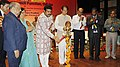"Dharmendra Pradhan lighting the lamp to launch the ""Pradhan Mantri Jeevan Jyoti Bima Yojana"", ""Pradhan Mantri Suraksha Bima Yojana"", and ""Atal Pension Yojana"", in Bhubaneswar, Odisha. The Governor of Odisha.jpg"