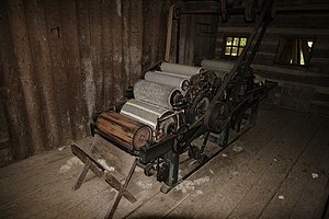 Putting-out system - 19th-century ox-powered double carding machine
