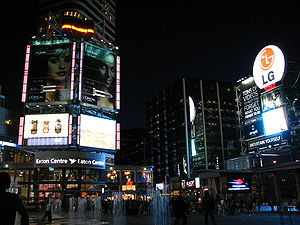 Downtown Yonge - Yonge-Dundas Square at night looking west towards the Toronto Eaton Centre