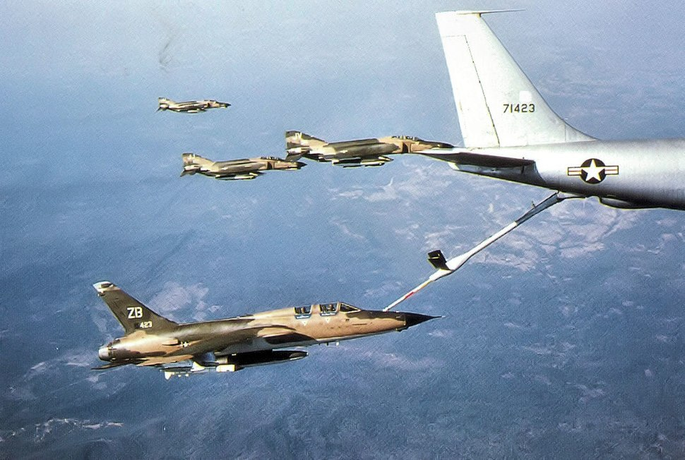 F-105 Wild Weasels and F-4 Phantoms refuel at a KC-135 on a mission to North Vietnam