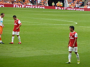 Cesc Fabregas and Carlos Vela of Arsenal.
