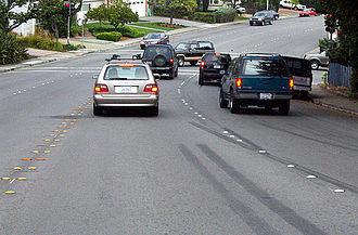 Botts' dots - Botts' dots replace the painted median stripes. Reflective Stimsonite (darker orange) markers are spaced at regular intervals for increased visibility at night.
