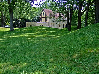 Mendota Mental Health Institute - A Farwell's Point Mound with Urben House in the background. Designed by Arthur Peabody, Urben House is a historic structure part of the Wisconsin Memorial Hospital Historic district and named for Walter J. Urben a former superintendent of Mendota State Hospital.