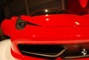 Ferrari 458 - The small aeroelastic winglets generate downforce and, as speed rises, deform to reduce the section of the radiator intake and cut drag.